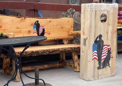 cornhole set and bench